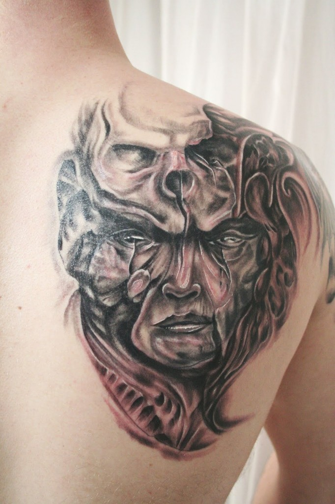 Fantasy world black and white mystical demon with skull tattoo on shoulder