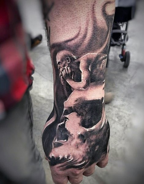 Fantasy world like big black and white monster with skull tattoo on arm