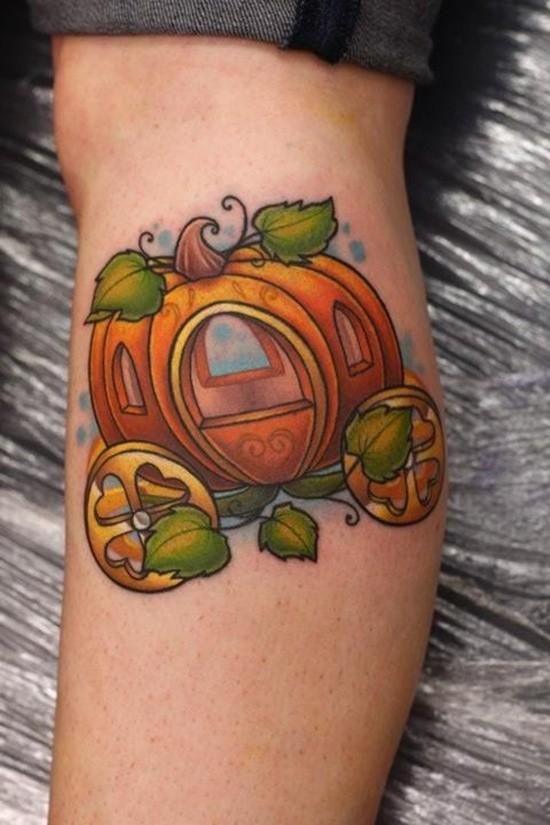 Fantasy world style little cute colored pumpkin coach tattoo on leg