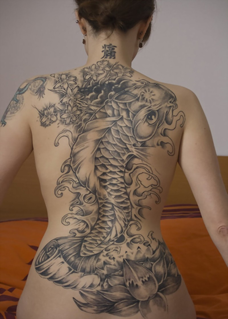 Fish and lotus flowers tattoo on back for girls