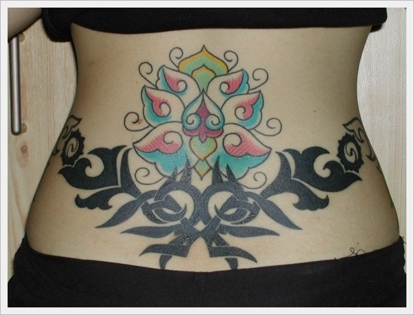 Floral patterns and black tribal tattoo on lower back