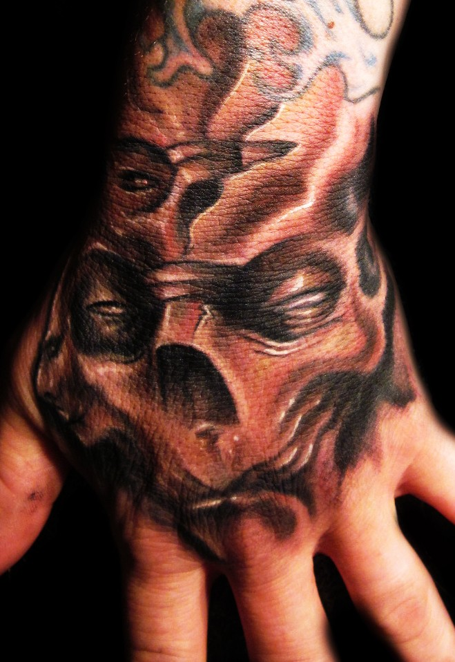 Monster skull tattoo on hand by hatefulss