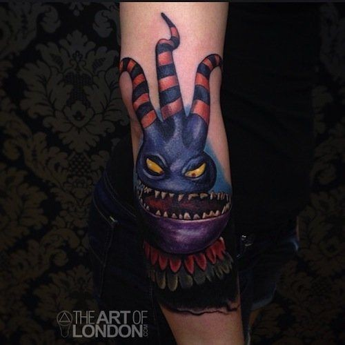Funny 3D like colored detailed forearm tattoo of cartoon monster
