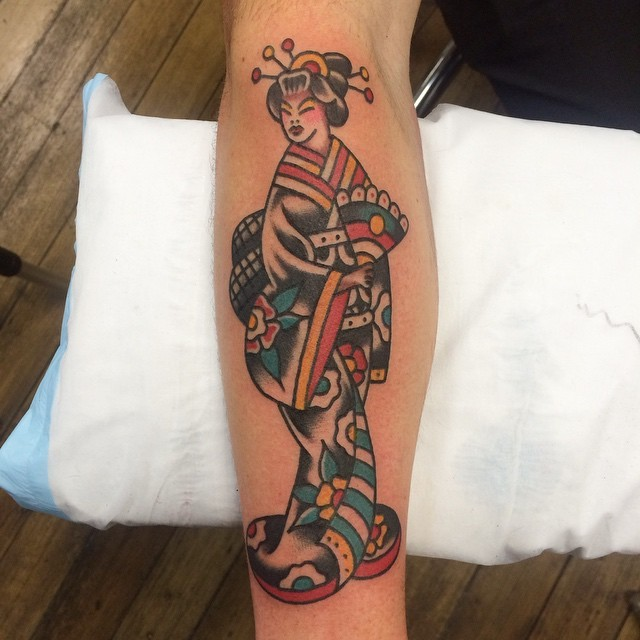 Funny Asian Geisha in kimono with hand fen colored forearm length tattoo in old school style