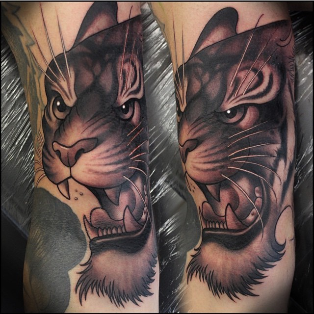 Funny cartoon like 3D style colored arm tattoo of roaring tiger