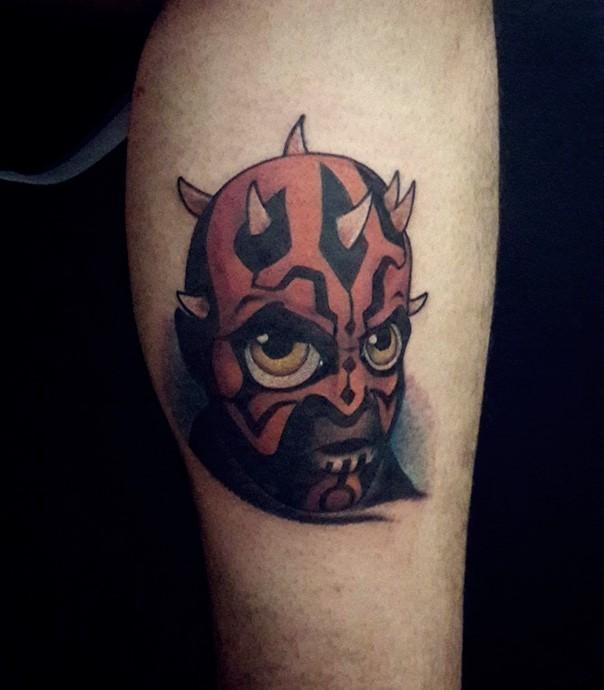 Funny cartoon like colored Darth Maul head tattoo on leg