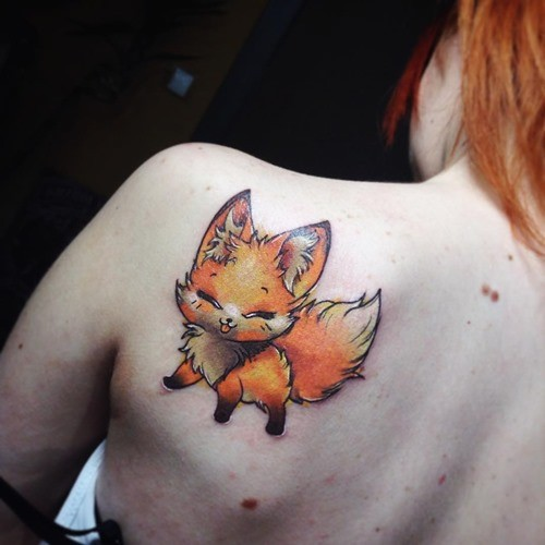 Funny cartoon like colored medium size shoulder tattoo of cute smiling fox
