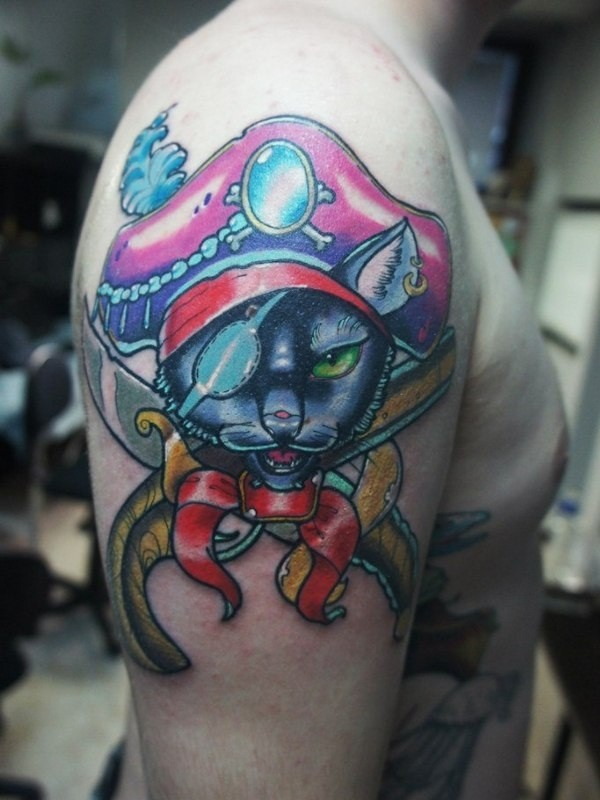 Funny cartoon like colored on shoulder tattoo of pirate cat