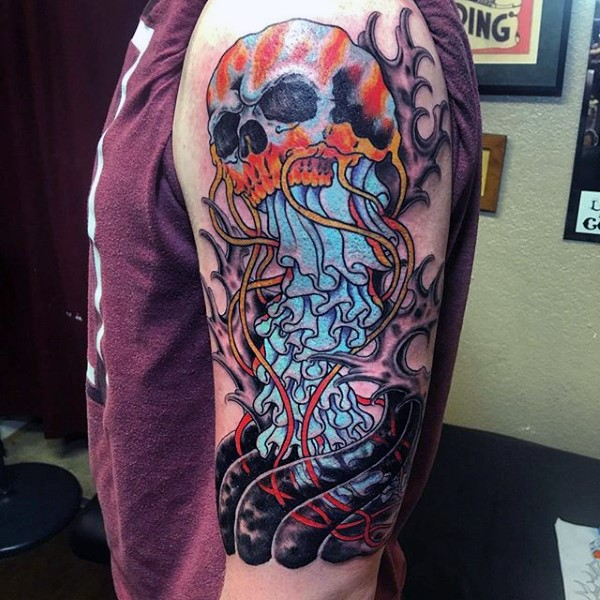 Funny cartoon like multicolored jellyfish tattoo on shoulder with skull
