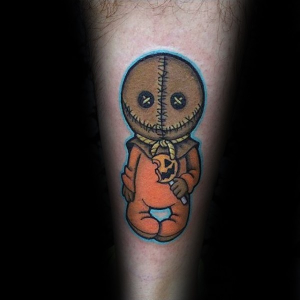 Funny cartoon style colored evil doll with lollypop tattoo on forearm
