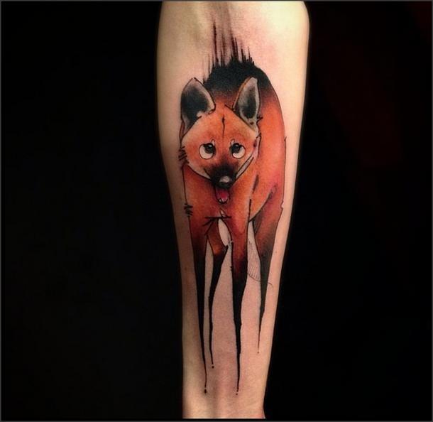 Funny cartoon style fox tattoo on forearm