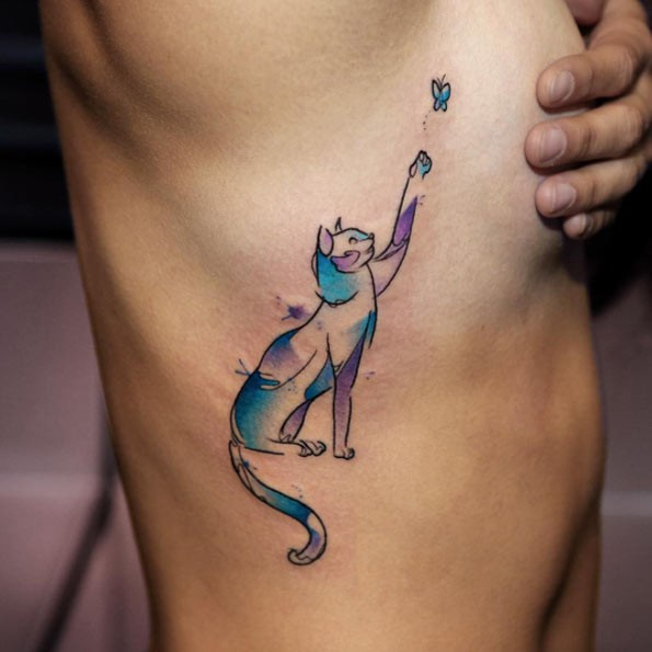 Funny colored little cat tattoo on side with butterfly