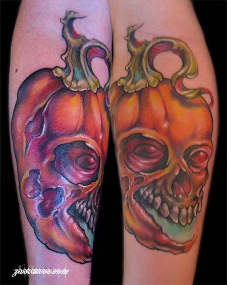 Funny designed colored and detailed forearm tattoo of skull shaped pumkin