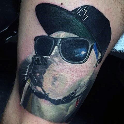 Funny gangsta like dog portrait tattoo on arm for Funny dog tattoos
