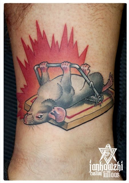 Funny idea mouse exercising in mousetrap colored tattoo on ankle with fire flames
