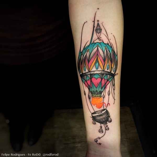 Funny illustrative style colored forearm tattoo of flying balloon
