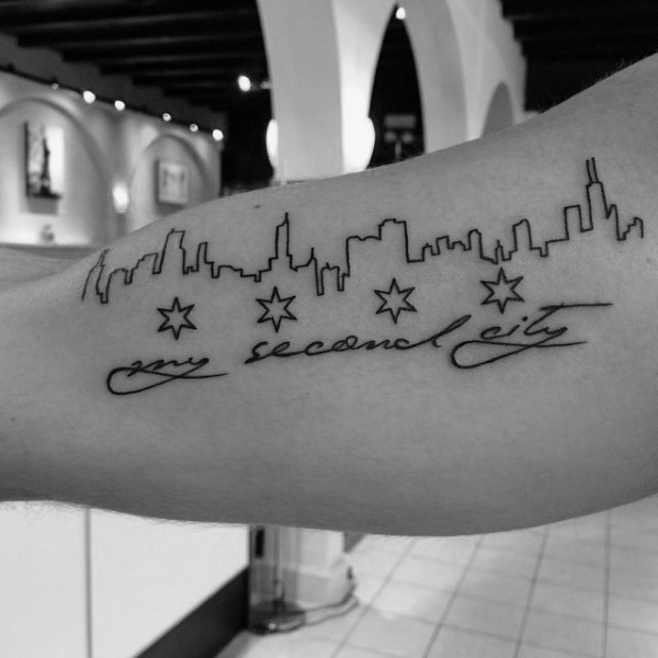 Funny looking black ink city shaped arm tattoo with lettering