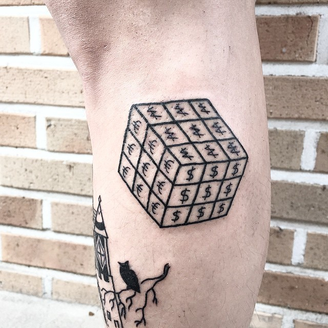 Funny looking black ink cube tattoo on leg stylized with various money symbols