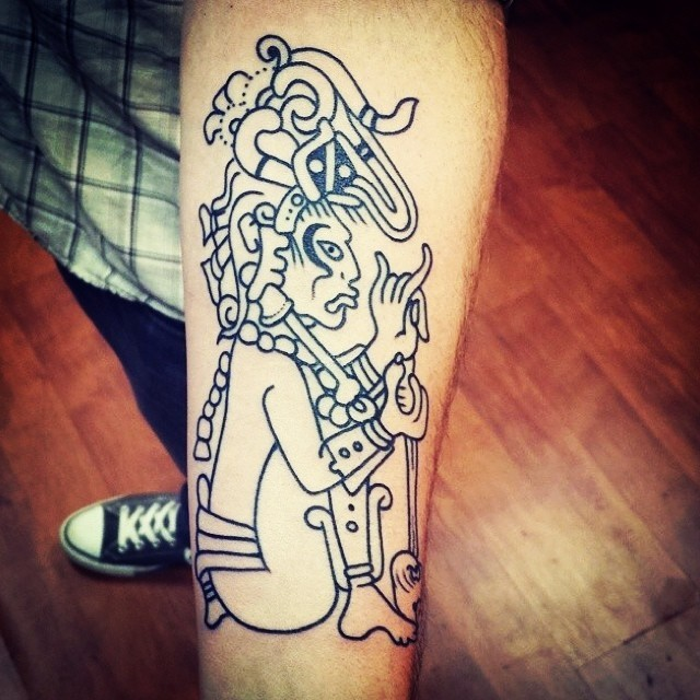 Funny looking cartoon style forearm tattoo of antic mystic painting