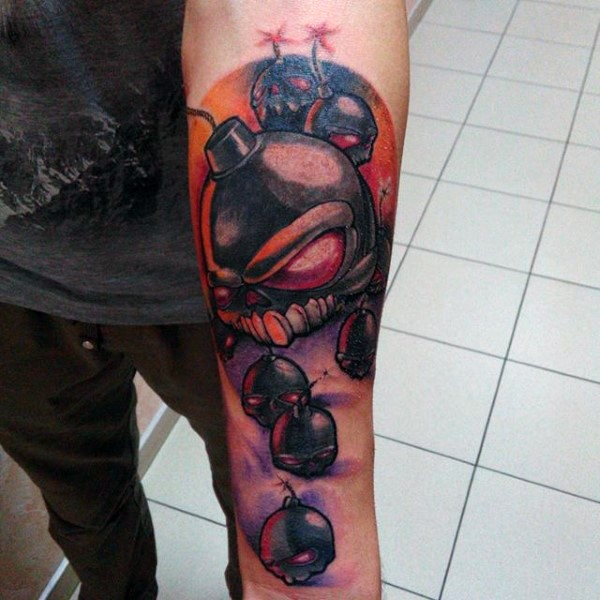 Funny looking colored forearm tattoo of crazy bombs