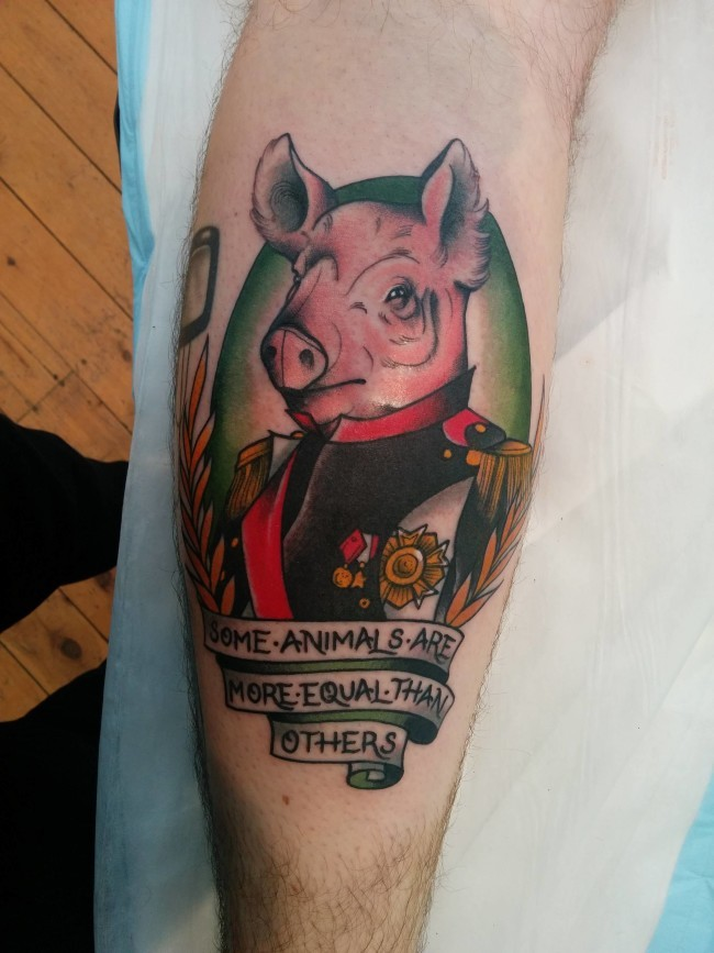 Funny looking colored leg tattoo of pig general with lettering