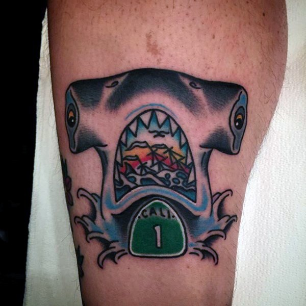 Funny looking colored leg tattoo of shark stylized with number and sailing ship