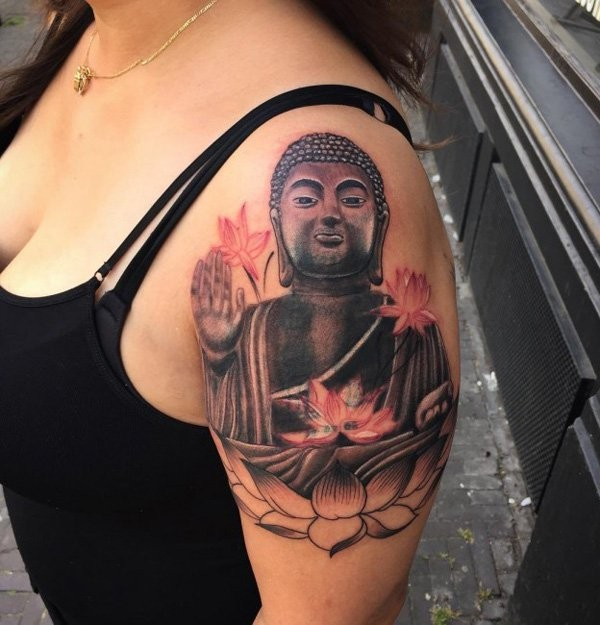 Funny looking colored shoulder tattoo of Buddha statue with flowers
