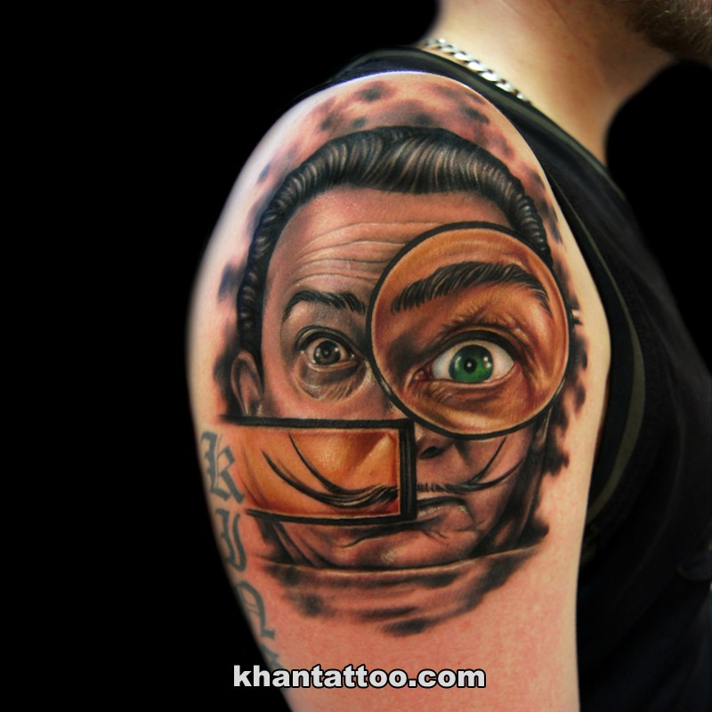 Funny looking colored shoulder tattoo of man portrait