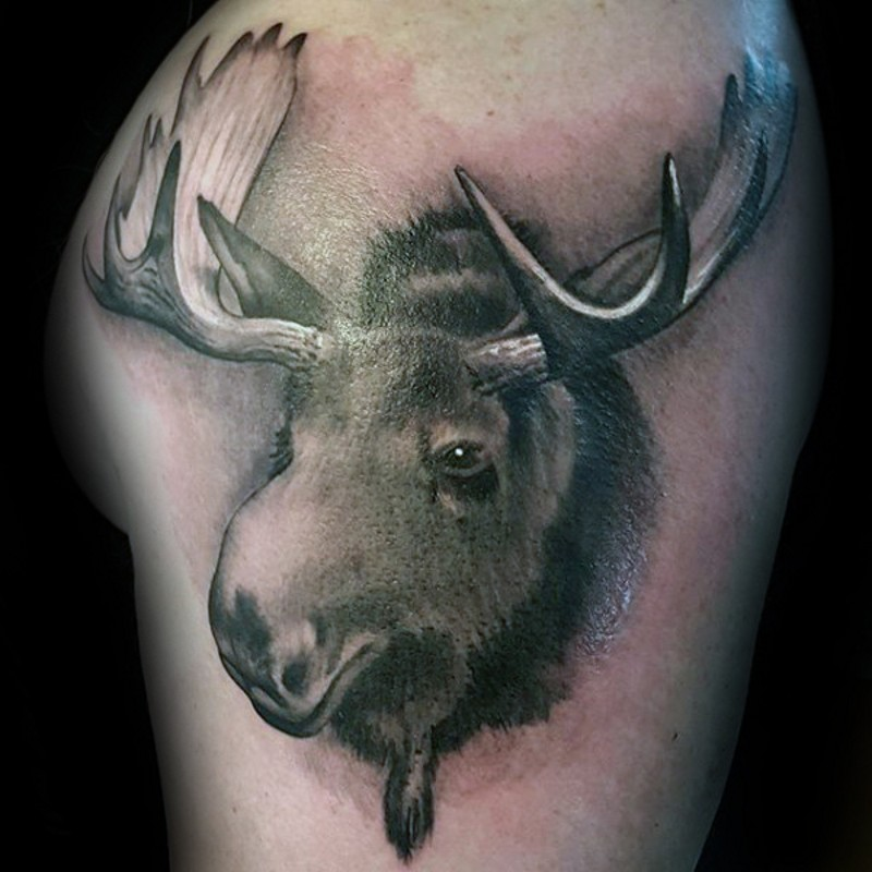 Funny looking detailed black and white elk head tattoo on upper arm