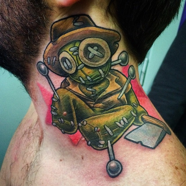 Funny looking multicolored voodoo doll tattoo on neck