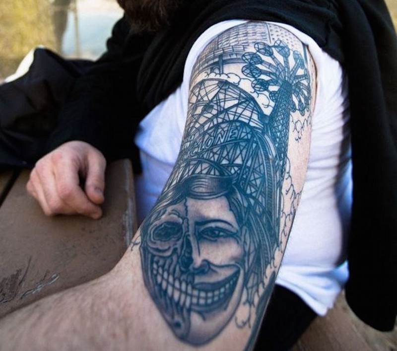 Funny looking shoulder tattoo of various roller coasters