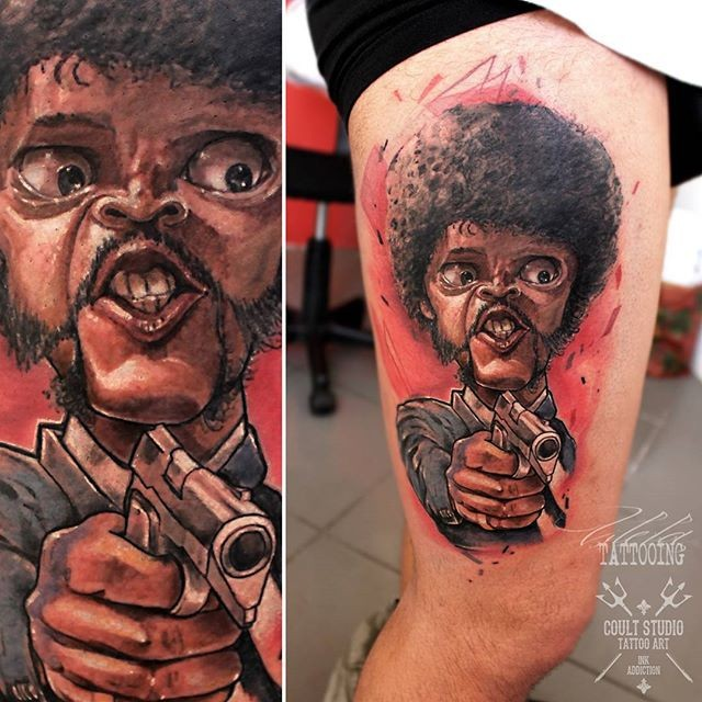 Funny looking thigh tattoo of movie hero with pistol