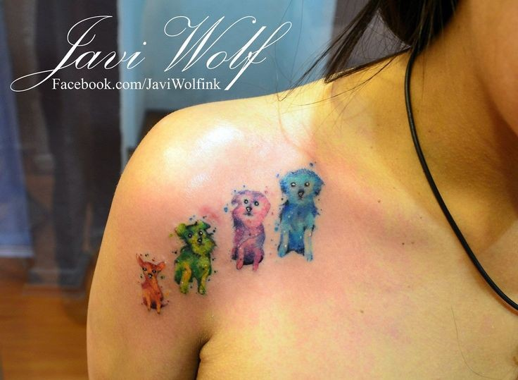 Funny looking watercolor style small puppies tattoo on shoulder