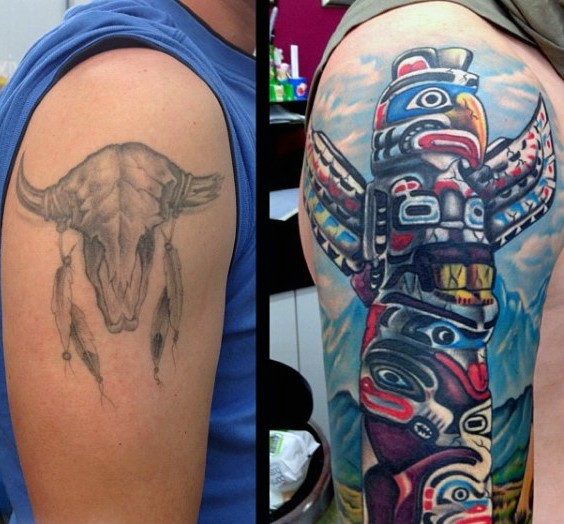 Funny multicolored tribal statue shoulder length tattoo