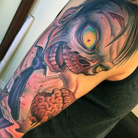 Funny multicolored zombie cartoon tattoo on shoulder
