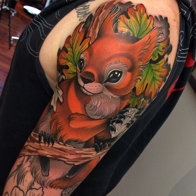 Funny new school style colored squirrel tattoo on shoulder with leaves
