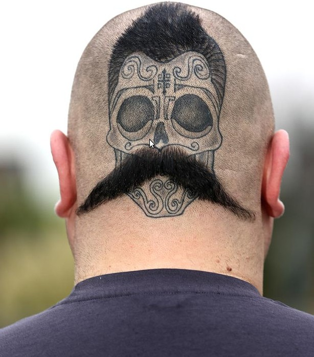 Funny painted and designed Mexican skull with mustache tattoo on head