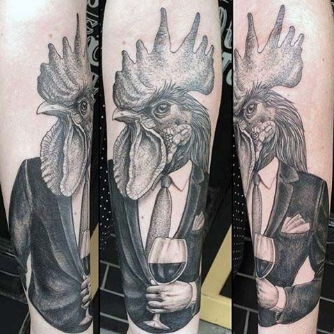 Funny painted black and white detailed gentleman with cock head tattoo on sleeve