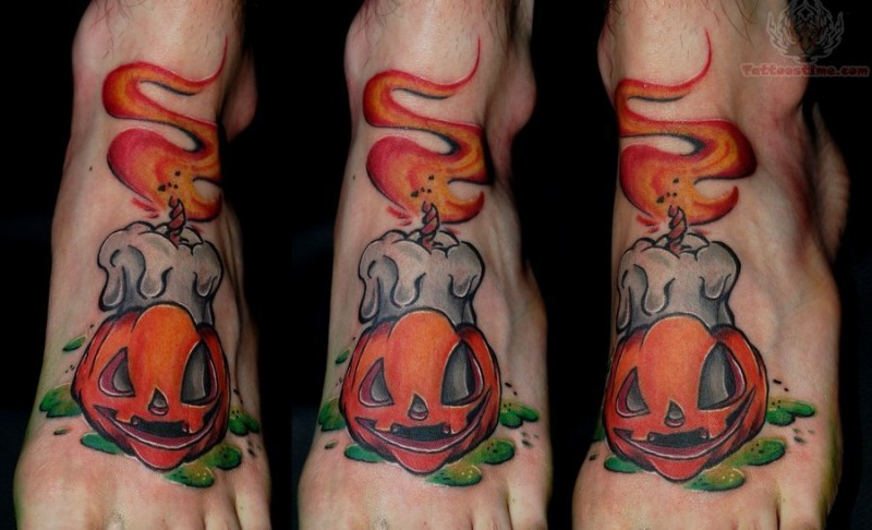 Funny painted colored burning candle tattoo on foot with pumpkin