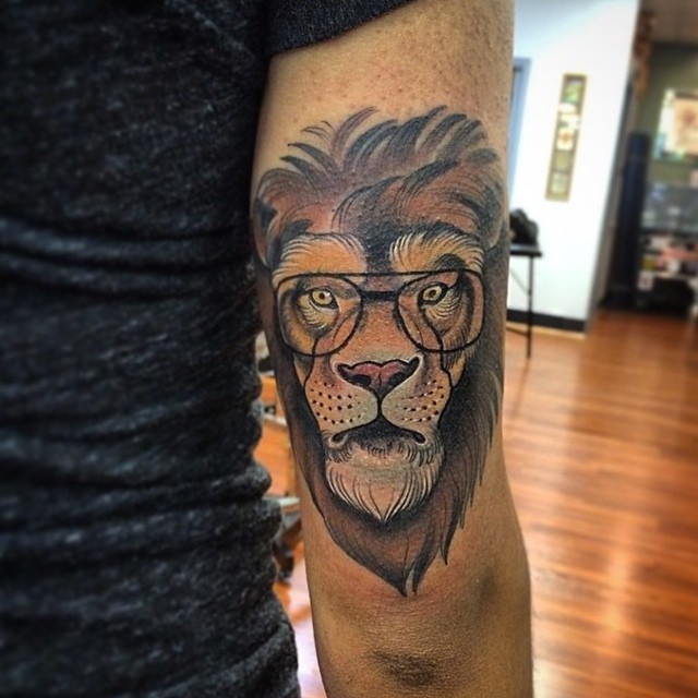 Funny painted colorful arm tattoo of lion in glasses