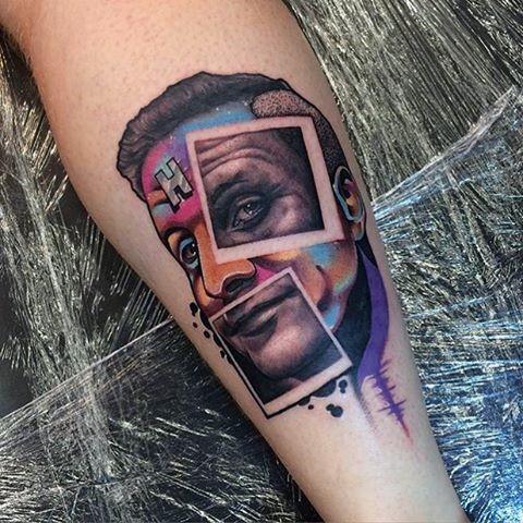 Funny painted multicolored half man half photos portrait tattoo on arm