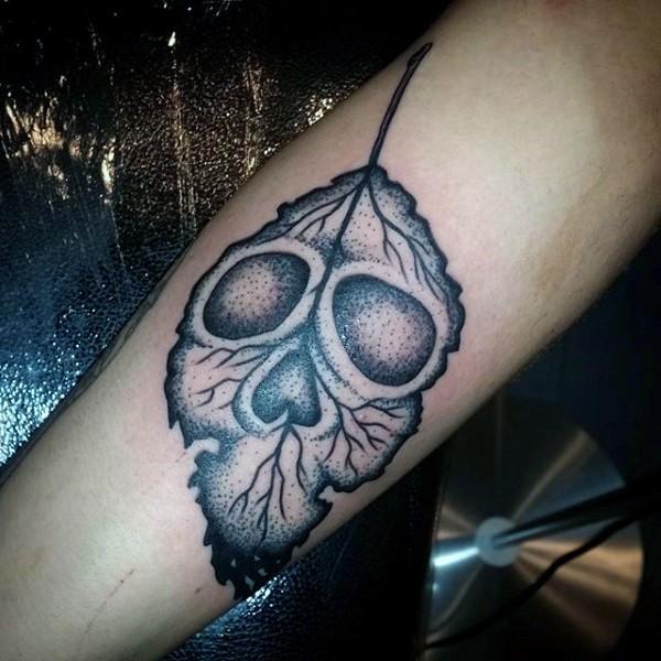 Funny skull like black ink little leaf tattoo on arm
