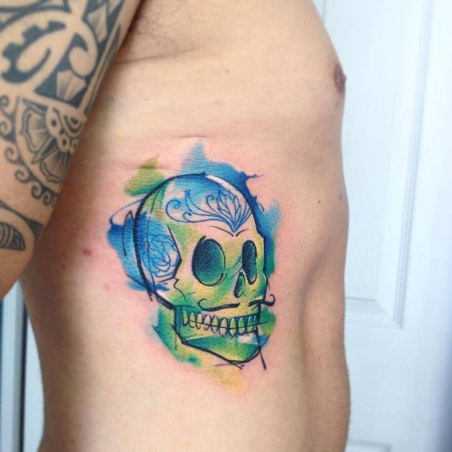 Funny skull with Italian mustashes side tattoo colored in watercolor style