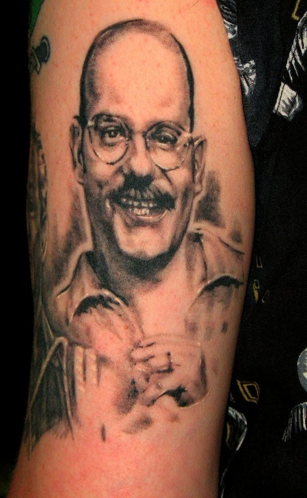 Funny smiling black and white realistic portrait tattoo on shoulder