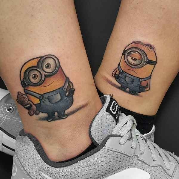 Funny traditionally colored cartoon heroes minions couple tattoo on ankles in 3D style