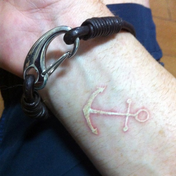 Funny white little cute anchor tattoo on wrist