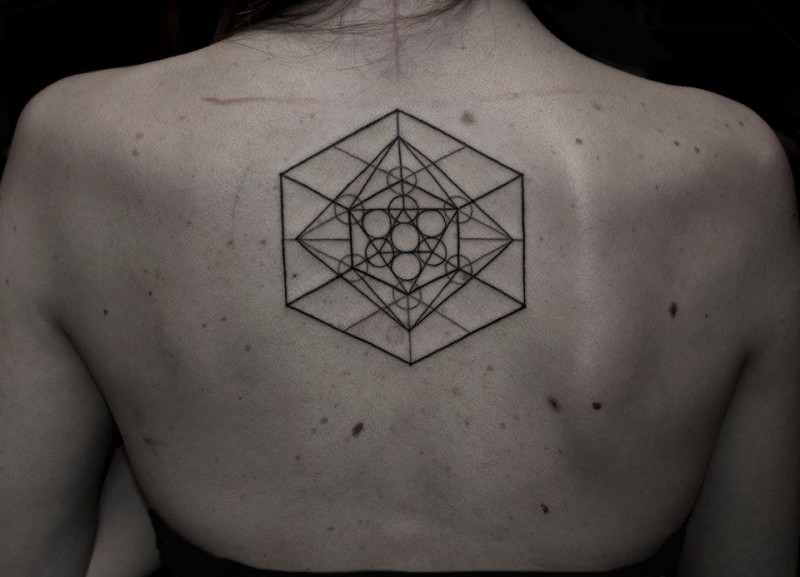 Geometric style black ink various ornaments tattoo on back