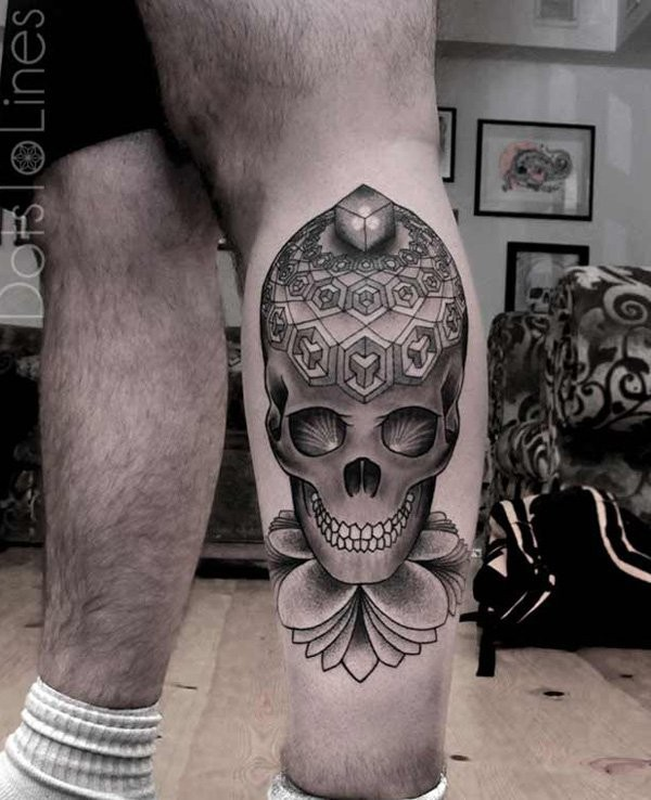Geometric style colored leg tattoo of human skull with figures