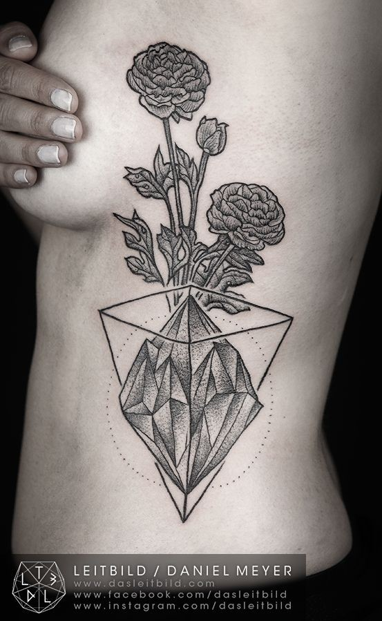 Geometric themed black ink flowers with diamond tattoo on chest