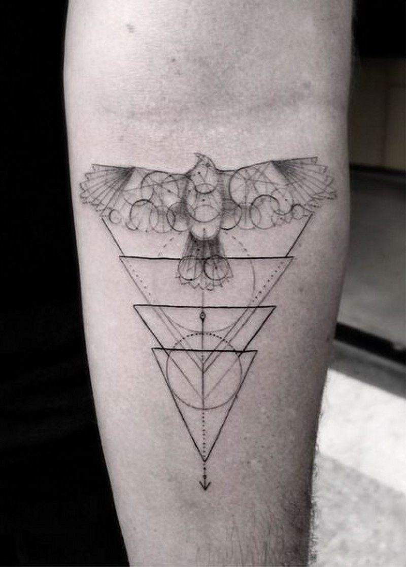 Geometrical style big black and white bird with figures tattoo on arm